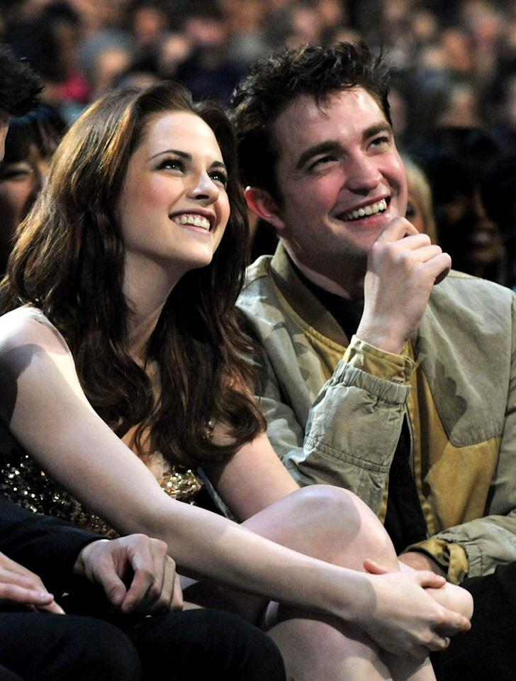 """On the same night, Kristen Stewart and Robert Pattinson kept fans guessing as to their relationship status at the People's Choice Awards. The pair, along with their """"Twilight"""" co-star Taylor Lautner, won Favorite On Screen Team in addition to a host of other awards at the fan-fueled shindig. Lester Cohen/<a href=""""http://www.wireimage.com"""" target=""""new"""">WireImage.com</a> - January 5, 2011"""