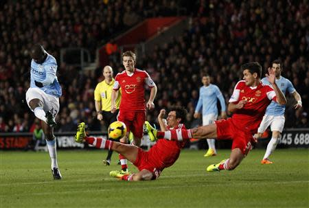 Manchester City's Yaya Toure (L) takes a shot on goal during their English Premier League soccer match against Southampton at St Mary's stadium in Southampton, southern England December 7, 2013. REUTERS/Stefan Wermuth