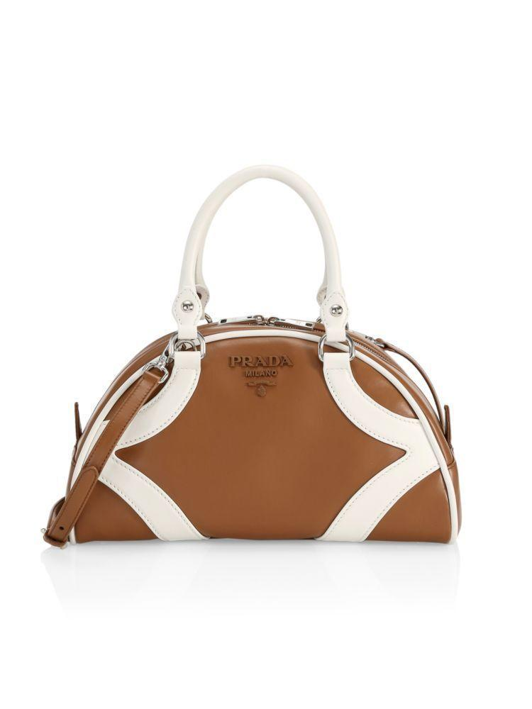 """<p><strong>Prada</strong></p><p>saksfifthavenue.com</p><p><strong>$2450.00</strong></p><p><a href=""""https://go.redirectingat.com?id=74968X1596630&url=https%3A%2F%2Fwww.saksfifthavenue.com%2Fprada-bowling-leather-top-handle-bag%2Fproduct%2F0400011904400&sref=https%3A%2F%2Fwww.harpersbazaar.com%2Ffashion%2Ffashion-week%2Fg30766342%2Ffall-2020-bag-trends%2F"""" rel=""""nofollow noopener"""" target=""""_blank"""" data-ylk=""""slk:Shop Now"""" class=""""link rapid-noclick-resp"""">Shop Now</a></p><p>A statement worth making.</p>"""