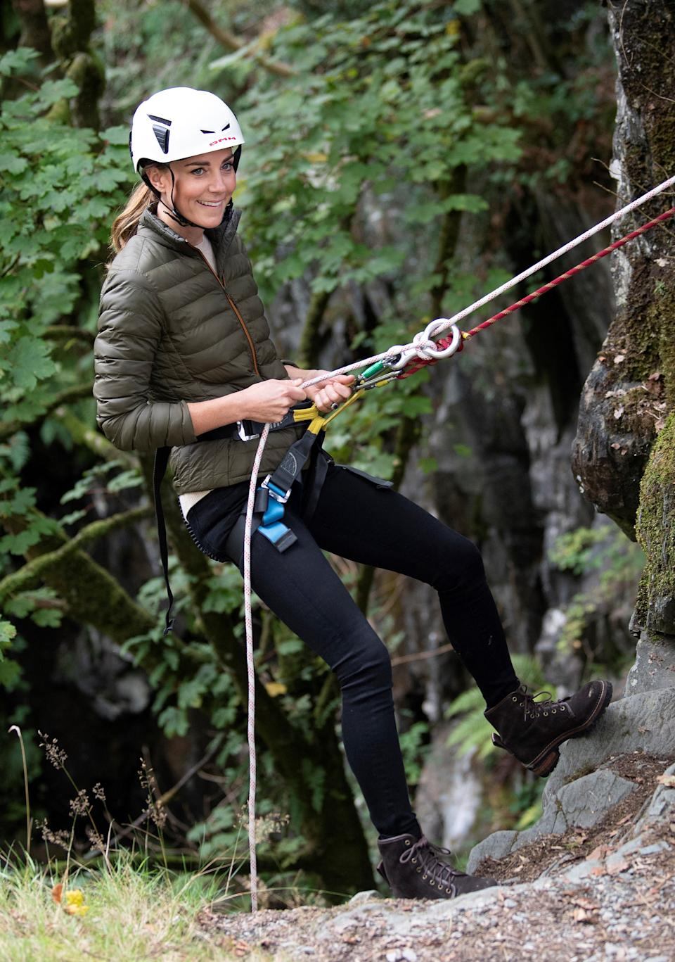 Britain's Catherine, Duchess of Cambridge, uses abseiling gear as she visits Royal Air Force (RAF) Air Cadets at their Windermere Adventure Training Centre near Ambleside in north west England on September 21, 2021. (Photo by Andy Stenning / POOL / AFP) (Photo by ANDY STENNING/POOL/AFP via Getty Images)