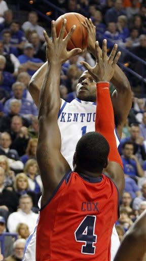 Kentucky's Darius Miller, top, shoots over Mississippi's Demarco Cox during the first half of an NCAA college basketball game in Lexington, Ky., Saturday, Feb. 18, 2012. (AP Photo/James Crisp)