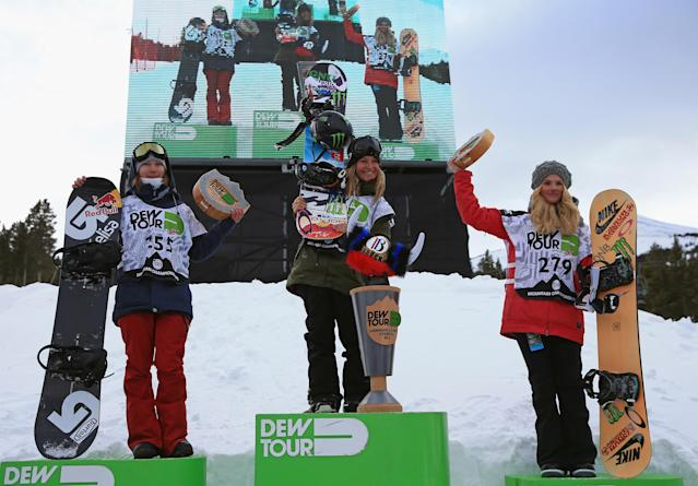 BRECKENRIDGE, CO - DECEMBER 13: (L-R) Enni Rukajarvi of Finland in second place, Jamie Anderson of the USA in first place and Silje Norendal of Norway in third place take the podium for the women's snowboard slopestyle at the Dew Tour iON Mountain Championships on December 13, 2013 in Breckenridge, Colorado. (Photo by Doug Pensinger/Getty Images)