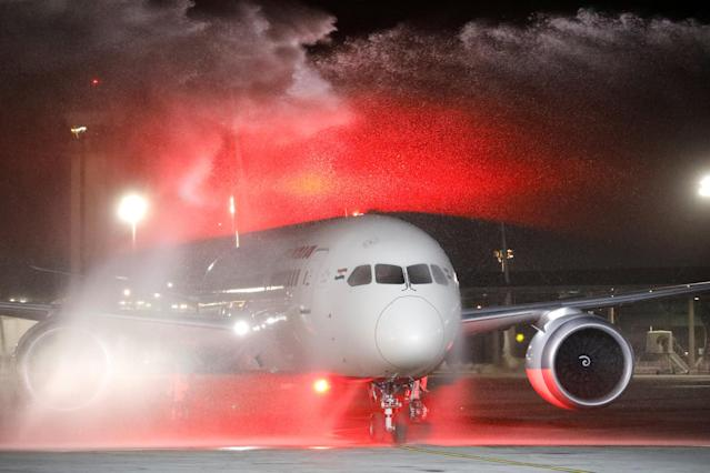 REFILE - CORRECTING TYPO An Air India Boeing 787-8 Dreamliner plane receives a water cannon salute upon its landing at Ben Gurion International Airport in Lod, near Tel Aviv, Israel, March 22, 2018. REUTERS/Amir Cohen TPX IMAGES OF THE DAY