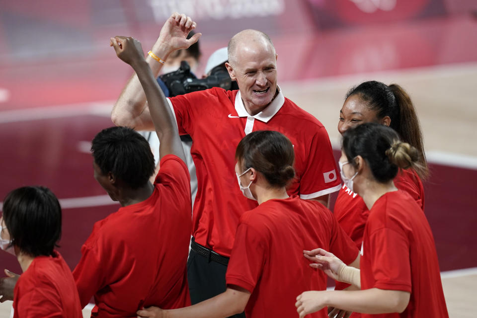 Japan head coach Thomas Hovasse celebrates with his team at the end of a women's basketball quarterfinal round game against Belgium at the 2020 Summer Olympics, Wednesday, Aug. 4, 2021, in Saitama, Japan. (AP Photo/Charlie Neibergall)