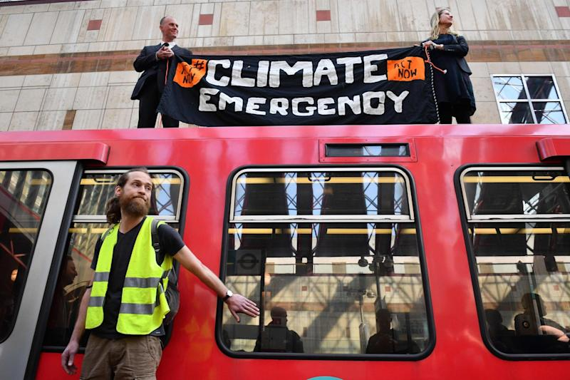 Climate change protestors in Canary Wharf station (AFP/Getty Images)