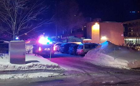 Police arrive at the scene of a fatal shooting at the Quebec Islamic Cultural Centre in Quebec City. REUTERS/Mathieu Belanger