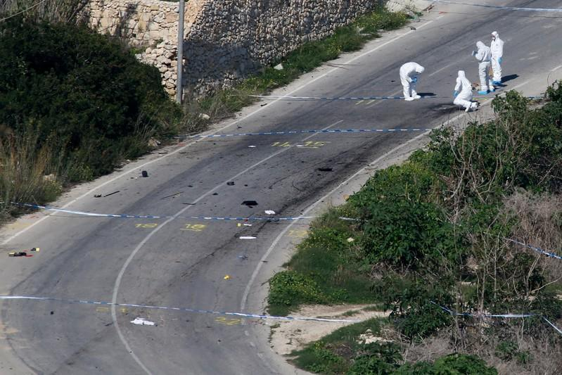 FILE PHOTO: Forensic experts work on the road as they conduct their investigation two days after a powerful bomb blew up a car killing investigative journalist Daphne Caruana Galizia in Bidnija