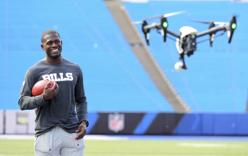 Buffalo Bills' first-round NFL football draft pick Tre'Davious White poses for a drone video camera following a media conference at New Era Field in Orchard Park, N.Y., Friday, April 28, 2017. (AP Photo/Bill Wippert)