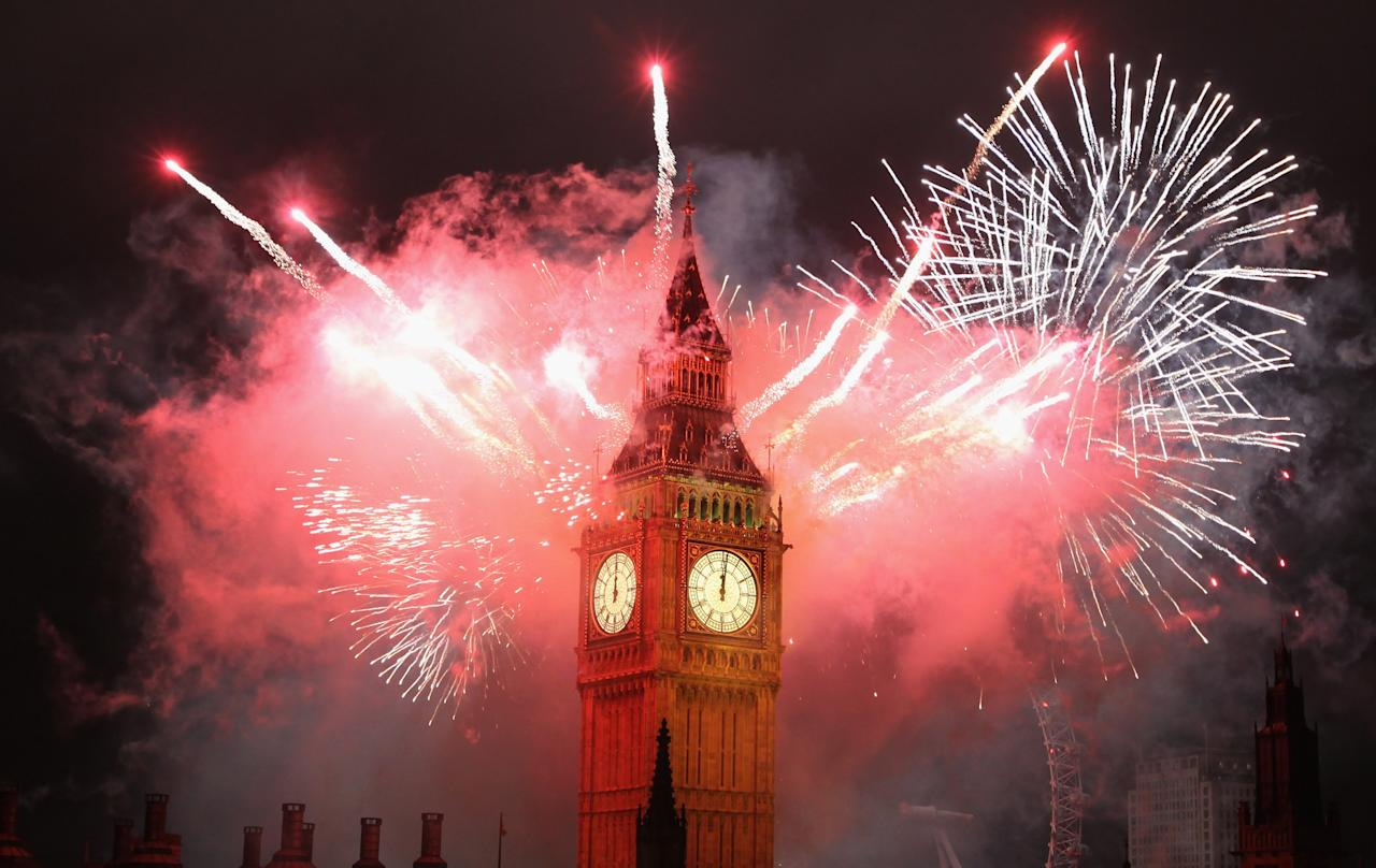 LONDON, ENGLAND - JANUARY 01:  Fireworks light up the London skyline and Big Ben just after midnight on January 1, 2012 in London, England. Thousands of people lined the banks of the River Thames in central London to ring in the New Year with a spectacular fireworks display.  (Photo by Dan Kitwood/Getty Images)
