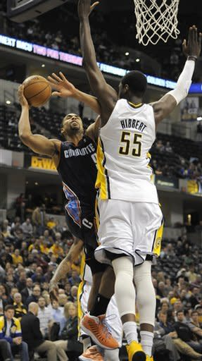 Charlotte Bobcats guard Gerald Henderson (9) shoots over Indiana Pacers center Roy Hibbert (55)in the first half of an NBA basketball game in Indianapolis, Wednesday, Feb. 13, 2013. (AP Photo/ Alan Petersime)