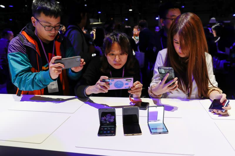 Attendees take photographs of the new Samsung Galaxy Z Flip foldable smartphone during Samsung Galaxy Unpacked 2020 in San Francisco