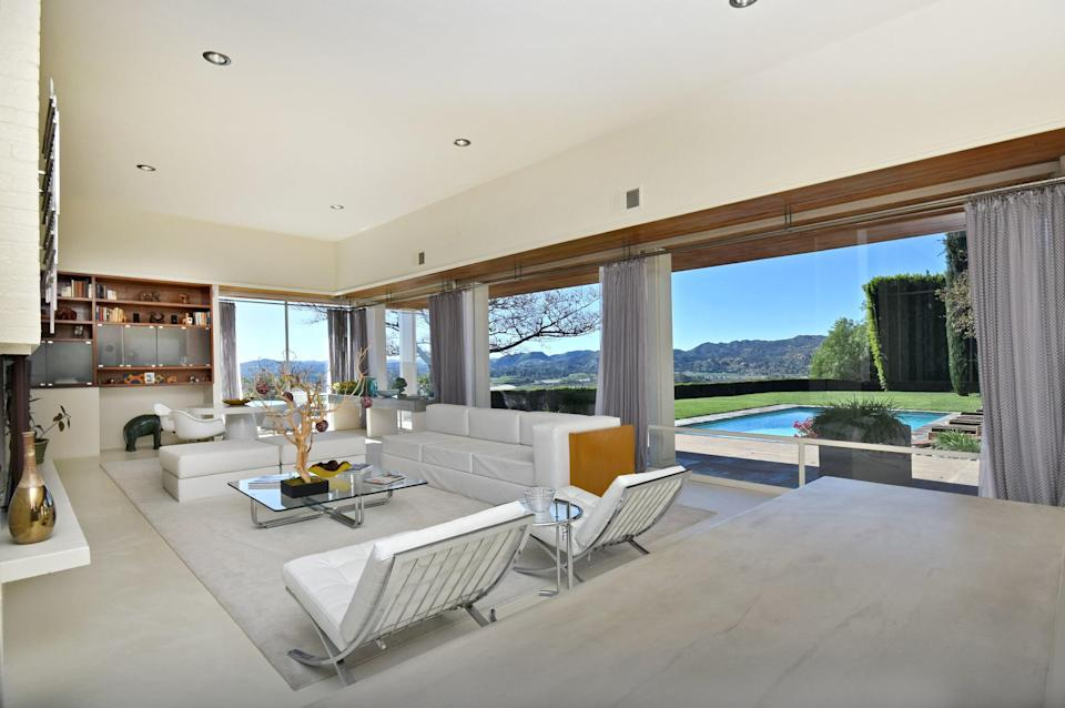 A casual living room with pool access.