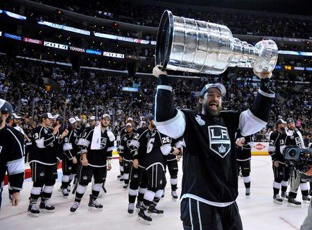 Kings winger Justin Williams hoists the Stanley Cup after defeating the Rangers in Game 5 of the 2014 Stanley Cup Final at Staples Center. (USA Today)