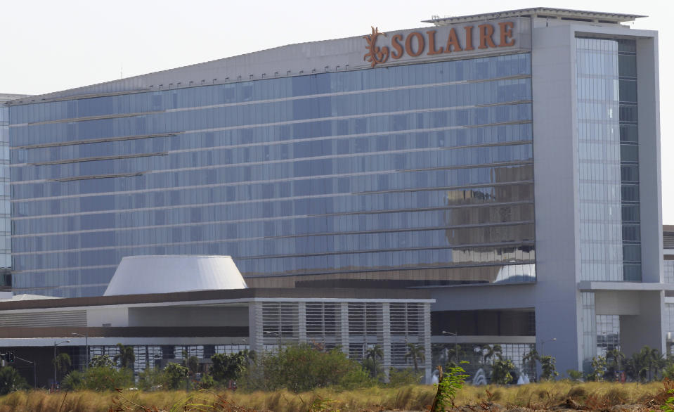 FILE PHOTO: The Solaire Hotel and Casino, which stands in a gaming complex, is seen along Macapagal road in Parañaque City, Metro Manila March 21, 2016. REUTERS/Romeo Ranoco