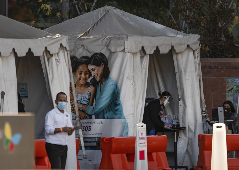 FILE - In this Dec. 18, 2020, file photo, medical tents for vaccinations are set outside the Children's Hospital Los Angeles. While shipments of the vaccine are rolling out to many health care workers and nursing homes across the country, it could be months before it's available for the general public. (AP Photo/Damian Dovarganes, File)