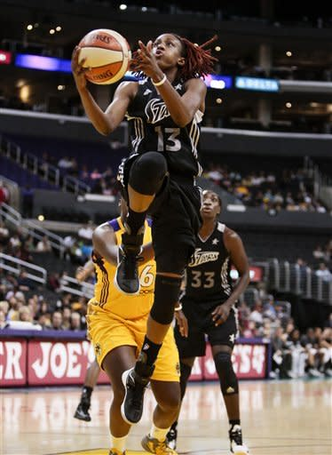 San Antonio Silver Stars guard Danielle Robinson makes a layup during the first half of a WNBA basketball game against the Los Angeles Sparks, Thursday, Aug. 23, 2012, in Los Angeles. (AP Photo/Bret Hartman)