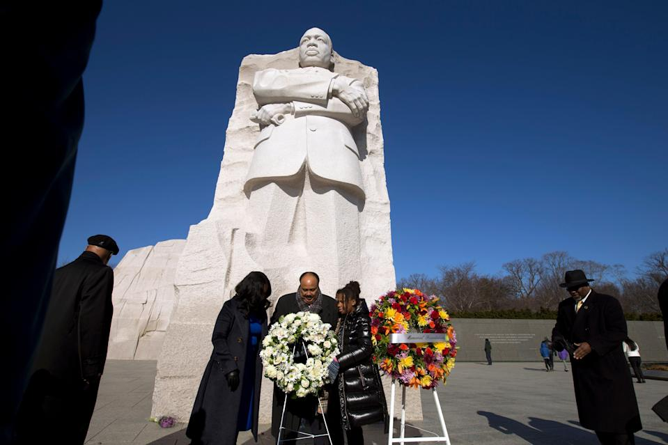 Martin Luther King III accompanied by his wife Andrea Waters King and his daughter Yolanda places a wreath at the base of Martin Luther King, Jr. Memorial during the 9th Annual Wreath Laying and Day of Reflection and Reconciliation, in Washington, Jan. 20, 2020.