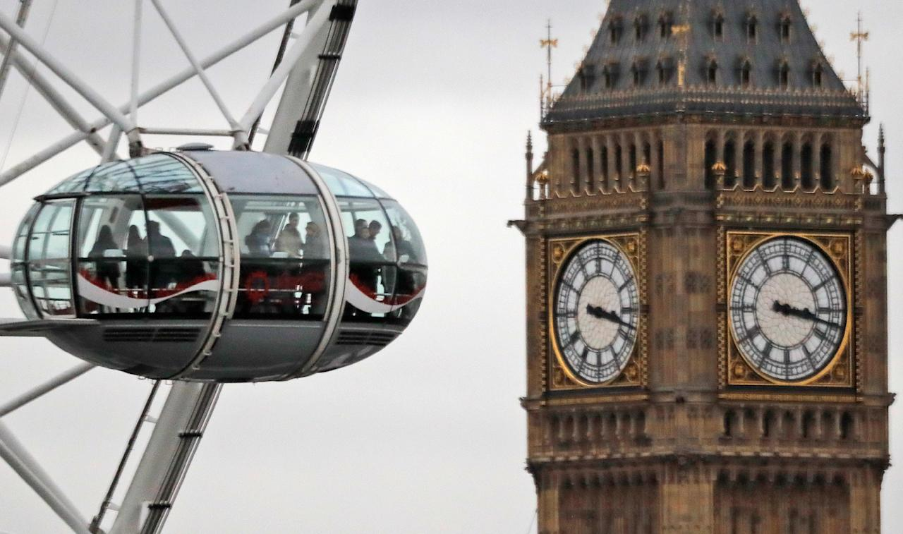 "<p> FILE - In this file photo dated Tuesday, Feb. 21, 2017, visitors enjoy the view from a pod on the London Eye overlooking Big Ben's clock tower and the Houses of Parliament in London. Many British businesses are trying to gauge the impact of the country's looming Brexit departure from the European Union, but the tourism industry is enjoying a ""Brexit bounce"" according to official figures released Friday Nov. 17, 2017, revealing a 5 percent increase on a year earlier. (AP Photo/Frank Augstein, FILE) </p>"