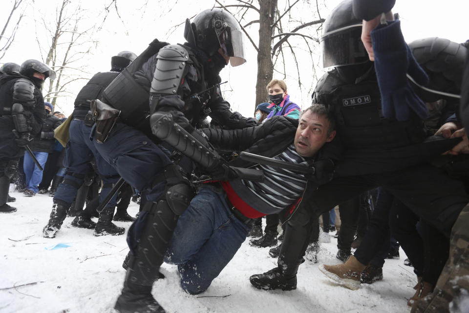 Police detain protesters during a protest against the jailing of opposition leader Alexei Navalny in St. Petersburg, Russia, Sunday, Jan. 31, 2021. Thousands of people have taken to the streets across Russia to demand the release of jailed opposition leader Alexei Navalny, keeping up the wave of nationwide protests that have rattled the Kremlin. Hundreds have been detained by police. (AP Photo/Valentin Egorshin)