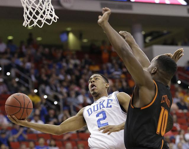 Duke guard Quinn Cook (2) moves against Mercer guard Ike Nwamu (10) during the first half of an NCAA college basketball second-round game, Friday, March 21, 2014, in Raleigh, N.C. (AP Photo/Gerry Broome)