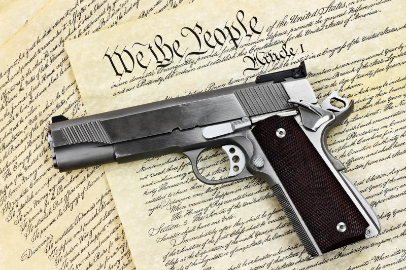 Handgun laying on the Constitution