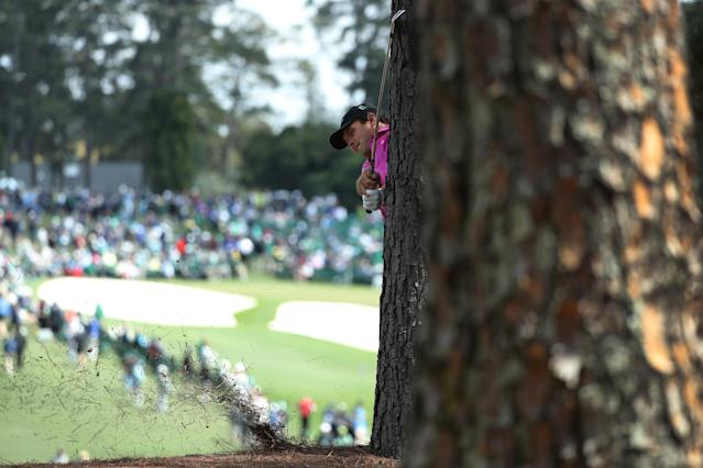 Patrick Reed of the U.S hits his second shot on the first hole from next to a tree during final round play of the 2018 Masters golf tournament at the Augusta National Golf Club in Augusta, Georgia, U.S. April 8, 2018. REUTERS/Lucy Nicholson TPX IMAGES OF THE DAY