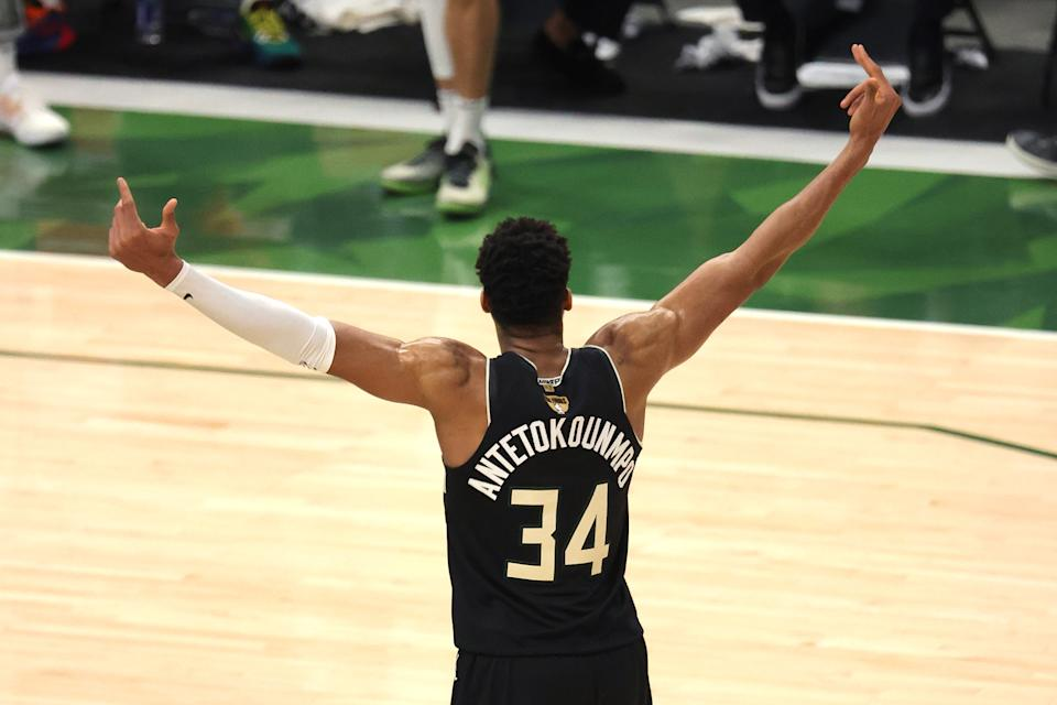 Giannis Antetokounmpo celebrates after defeating the Phoenix Suns in Game Six to win the 2021 NBA championship at Fiserv Forum on July 20, 2021 in Milwaukee. (Jonathan Daniel/Getty Images)