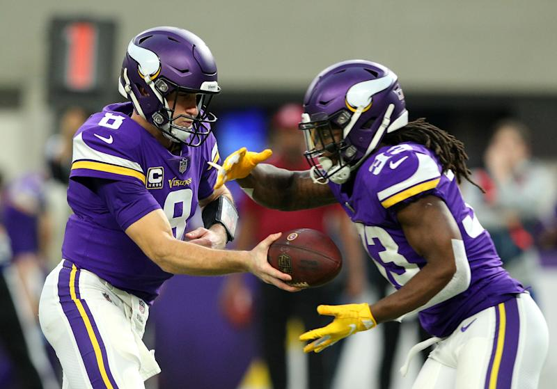 MINNEAPOLIS, MN - DECEMBER 30: Kirk Cousins #8 of the Minnesota Vikings hands the ball off to Dalvin Cook #33 in the first quarter of the game against the Chicago Bears at U.S. Bank Stadium on December 30, 2018 in Minneapolis, Minnesota. (Photo by Adam Bettcher/Getty Images)