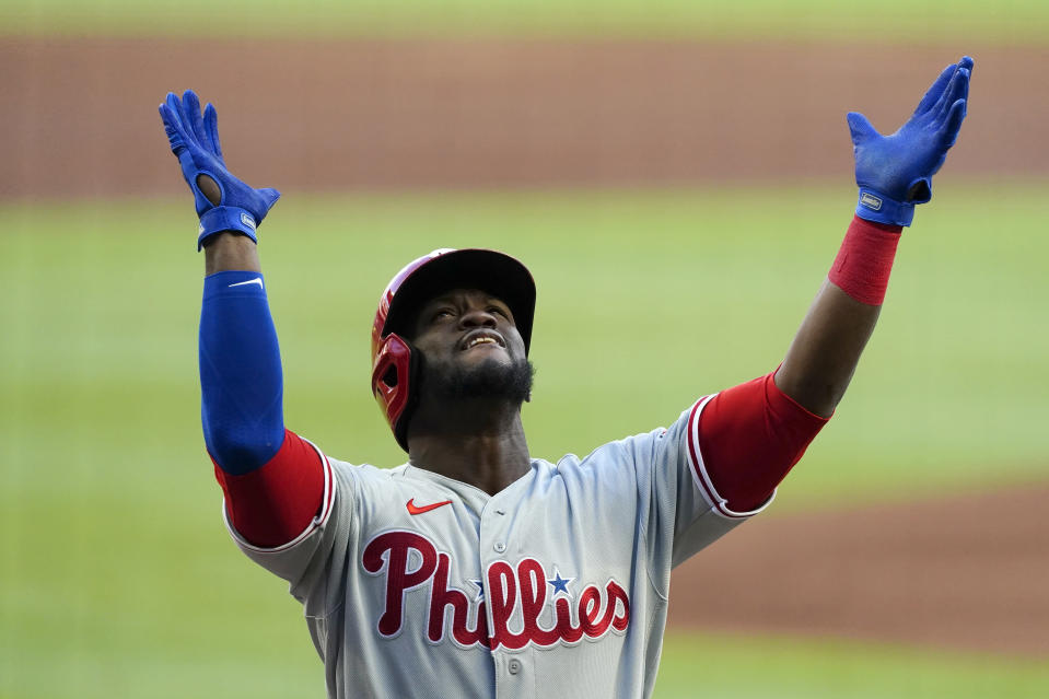 Philadelphia Phillies' Odubel Herrera reacts as he crosses the plate after hitting a three-run home run in the first inning of a baseball game against the Atlanta Braves, Friday, May 7, 2021, in Atlanta. (AP Photo/John Bazemore)