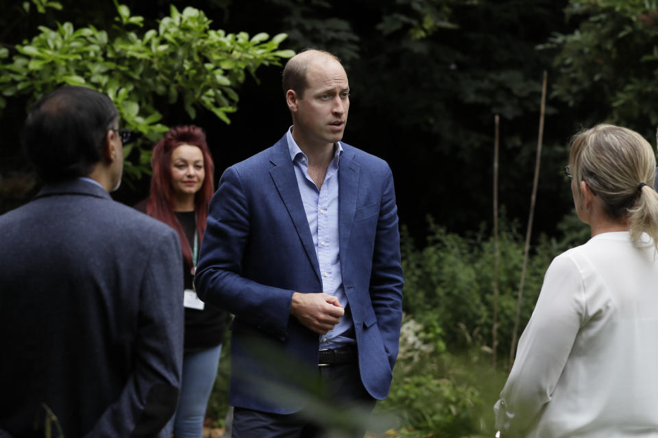 EMBARGOED TO 2200 SATURDAY JULY 18 The Duke of Cambridge speaks with Fay Hirel, Head of Care and Support for the Longhurst Group (right) and Ali Manji, Service Manager for Cross Keys Homes (left) during a visit to the Garden House part of the Peterborough Light Project, a charity which offers advice and support to rough sleepers.
