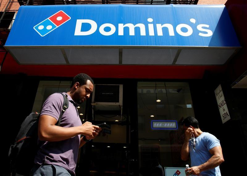 People pass by a Domino's Pizza restaurant in New York