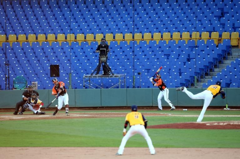 Baseball games are taking place behind closed doors in Taiwan (AFP Photo/Steven Lee)