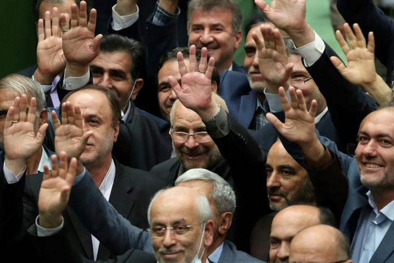 New parliament speaker Mohammad-Bagher Ghalibaf (C), surrounded my MPs, is a former Tehran mayor, national police chief and commander of the Revolutionary Guards' air force