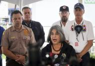 Miami-Dade mayor Daniella Levine Cava gives her remarks during the daily morning press conference outside the County's operational center on Sunday, July 11, 2021 in Surfside, Fla. Miami-Dade and Surfside mayors updated the media on the overnight and daily operational details after the partial collapse of the Champlain Towers South. (Carl Juste/Miami Herald via AP)
