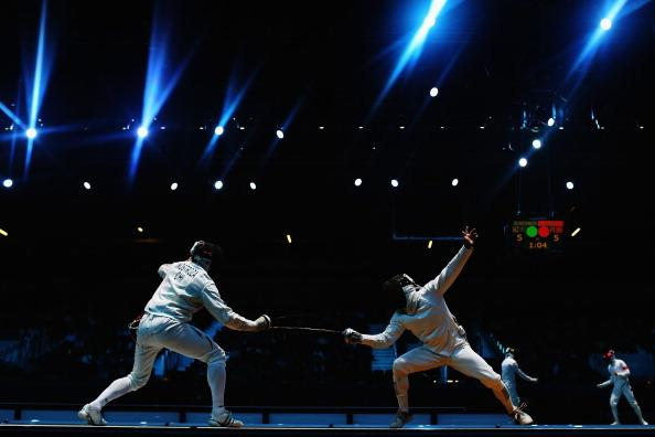 LONDON, ENGLAND - AUGUST 01:  Paris A. Inostroza Budinich of Chile competes against Max Heinzer of Switzerland in the Men's Individual Epee round of 32 match on Day 5 of the London 2012 Olympic Games at ExCeL on August 1, 2012 in London, England.  (Photo by Hannah Johnston/Getty Images)