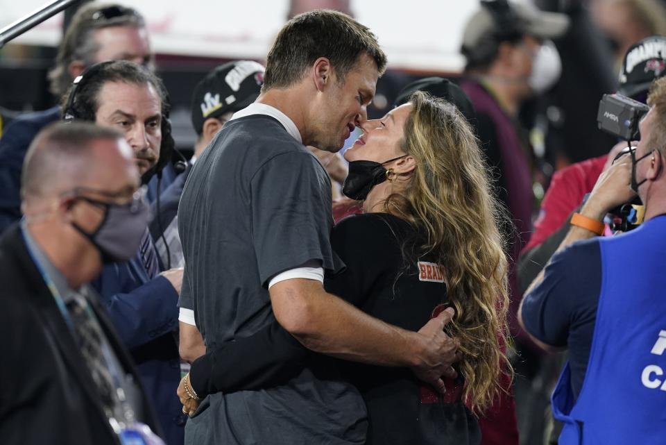 Tampa Bay Buccaneers quarterback Tom Brady kisses wife Gisele Bundchen after defeating the Kansas City Chiefs in the NFL Super Bowl 55 football game Sunday, Feb. 7, 2021, in Tampa, Fla. (AP Photo/Mark Humphrey)