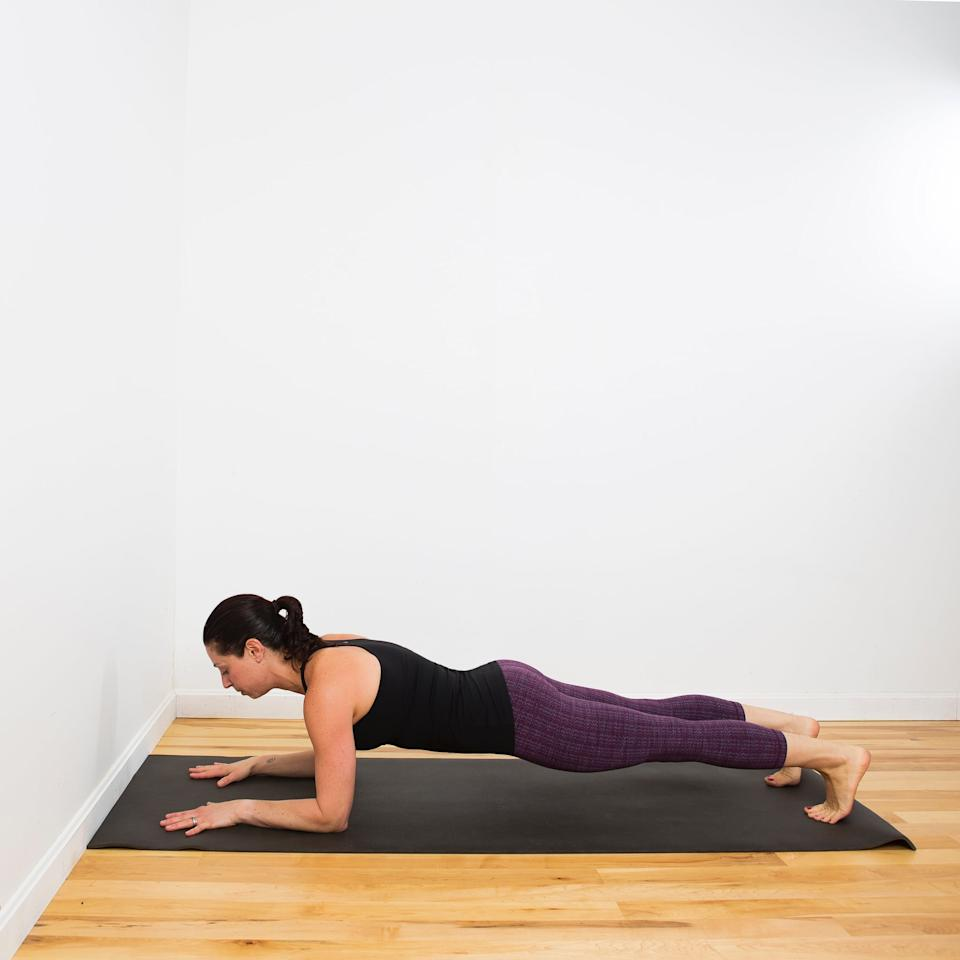 """<p><strong>How this pose helps:</strong> strengthens core and upper body</p> <ul> <li>From <a href=""""https://www.popsugar.com/fitness/Downward-Facing-Dog-2671016"""" class=""""ga-track"""" data-ga-category=""""Related"""" data-ga-label=""""http://www.fitsugar.com/Downward-Facing-Dog-2671016"""" data-ga-action=""""In-Line Links"""">Downward Facing Dog</a>, inhale and shift your weight forward coming into plank position (top of a push-up). Exhale as you lower onto your forearms so that your shoulders are stacked directly above your elbows and your body is parallel with the floor.</li> <li>If you can't hold for five breaths, lower one or both knees to the floor.</li> </ul>"""