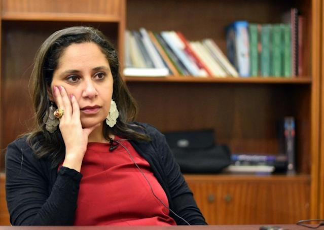 An Egyptian court has ordered a freeze on the assets of Nazra for Feminist studies and its founder Mozn Hassan (C) (AFP Photo/Mohamed el-Shahed)