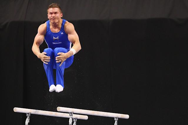 ST. LOUIS, MO - JUNE 7: Jonathan Horton competes in the parallel bars exercise during the Senior Men's competition on day one of the Visa Championships at Chaifetz Arena on June 7, 2012 in St. Louis, Missouri. (Photo by Dilip Vishwanat/Getty Images)