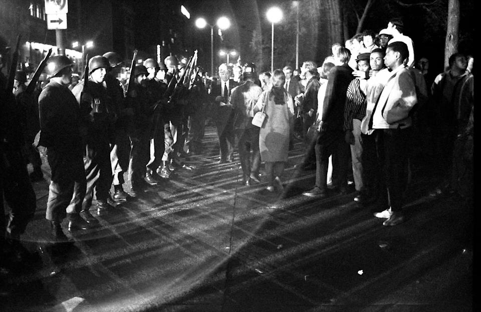 A line of National Guardsmen stand across from a group of protesters during widespread demonstrations at the Democratic National Convention in Chicago in 1968.