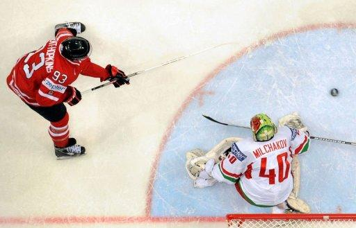 Canada's Ryan Nugent-Hopkins shoots against Belarus' goalie Dmitri Milchakov