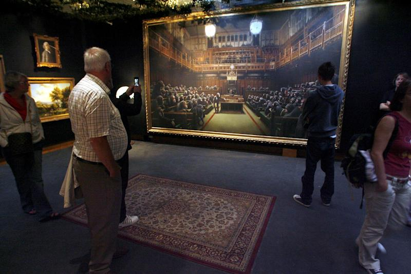 Devolved Parliament, which is four metres wide, was first unveiled as part of the Bristol artist's exhibition Banksy vs Bristol Museum in 2009. (SWNS)