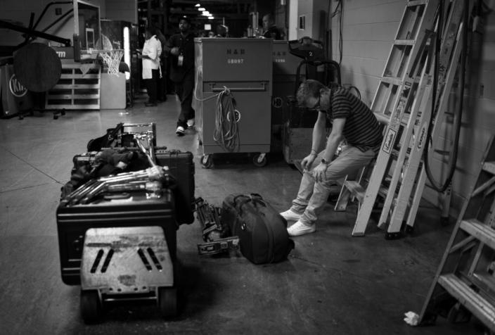 <p>William Roane, with CBS News, rests after moving equipment Tuesday, July 26, 2016, in Philadelphia, PA. (Photo: Khue Bui for Yahoo News) </p>