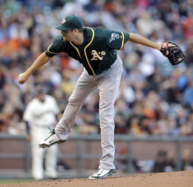 Oakland Athletics' Jason Hammel follows through on a pitch against the San Francisco Giants in the first inning of a baseball game Wednesday, July 9, 2014, in San Francisco. (AP Photo/Ben Margot)