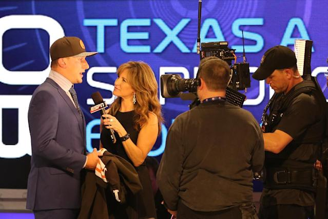 Johnny Manziel is interviewed by Suzy Kolber after being selected by the Cleveland Browns at the 2014 NFL Draft at Radio City on Thursday, May 8th, 2014 in New York, NY. (AP Photo/Gregory Payan)