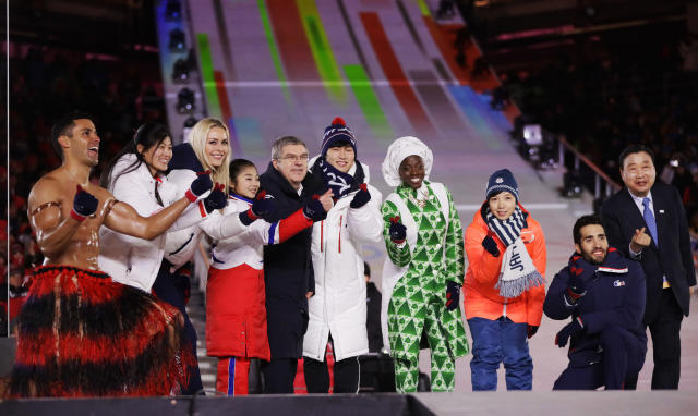 Pita Taufatofua, far left, once again made an Olympics ceremony his own personal showcase. (AP)