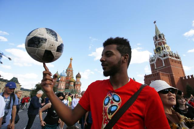 Soccer Football - World Cup - Group B - Portugal vs Morocco - Moscow, Russia - June 20, 2018. Morocco soccer fan plays with the ball at the Red Square after the match REUTERS/Sergei Karpukhin