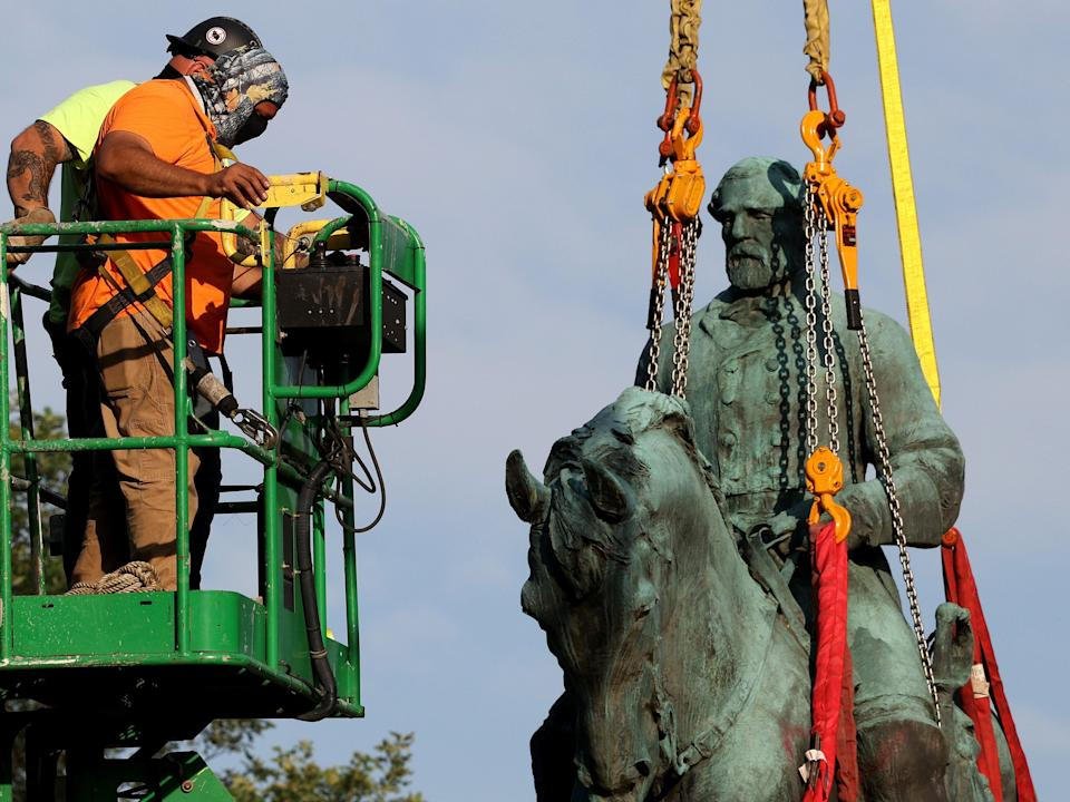 Workers remove a statue of Confederate General Robert E. Lee from Market Street Park July 10, 2021 in Charlottesville, Virginia. (Getty Images)