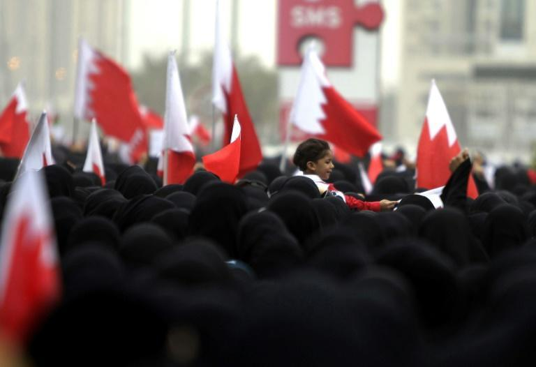 Bahraini Shiite anti-government protesters take part in a rally in remembrance of the seven people who were killed in police crackdowns as they march towards Pearl Square in Manama on February 25, 2011