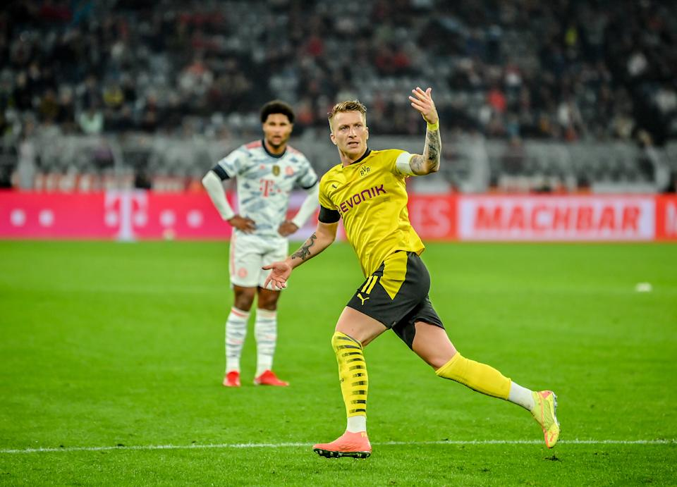 DORTMUND, GERMANY - AUGUST 17: Marco Reus of Dortmund celebrates after scoring his team's first goal during the Supercup 2021 match between FC Bayern München and Borussia Dortmund at Signal Iduna Park on August 17, 2021 in Dortmund, Germany. (Photo by Sebastian Widmann/Bundesliga/Bundesliga Collection via Getty Images)